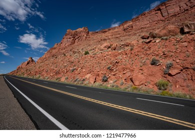 American road through the orange red mountains. empty street highway. on way from grand canyon to page arizona usa. climb mountain road.United states US steep gradient streets. uphill to the goal