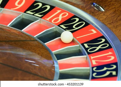 American Roulette wheel with a ball in the number