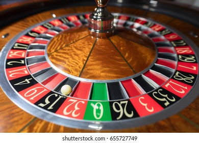 American Roulette wheel with a ball in the number '15'