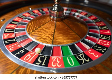 American Roulette wheel with a ball in the number '19'