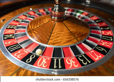 American Roulette wheel with a ball in the number '8'