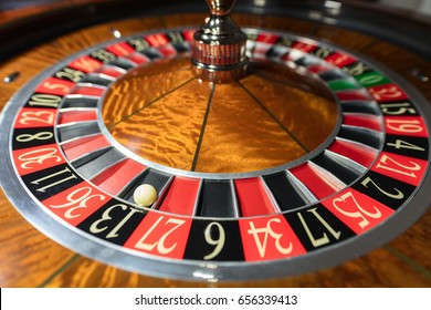 American Roulette wheel with a ball in the number '13'