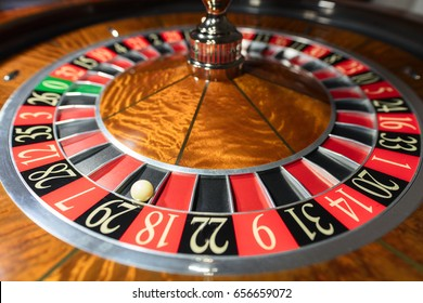 American Roulette wheel with a ball in the number '29'