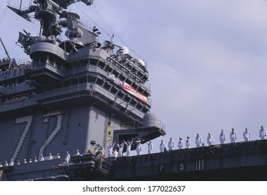 """American Sailors on Deck of Aircraft Carrier with banner saying """"Mission Accomplished that President George W. Bush spoke from."""