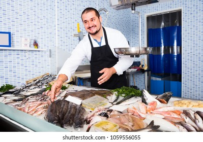 american seller in white cover-slut smiling showing fish lying