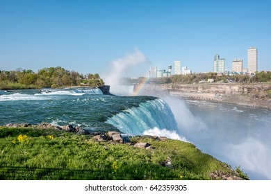 American side of Niagara Falls waterfall with rainbow, view of Canadian side from New York state, USA