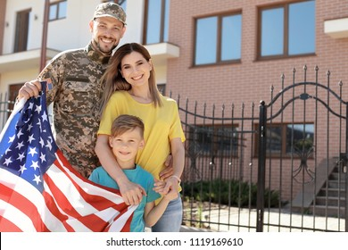 American soldier reunited with his family outdoors. Military service