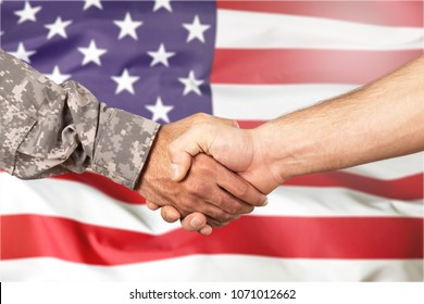 American soldier in uniform and civil man