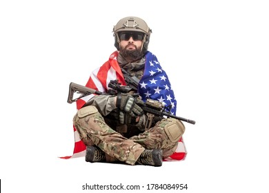 american soldier in uniform with usa flag sits on white isolated background, ranger with military ammunition, hero of america