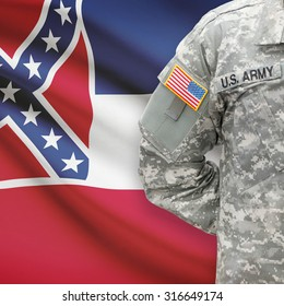 American soldier with US state flag on background series - Mississippi
