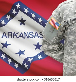 American soldier with US state flag on background series - Arkansas