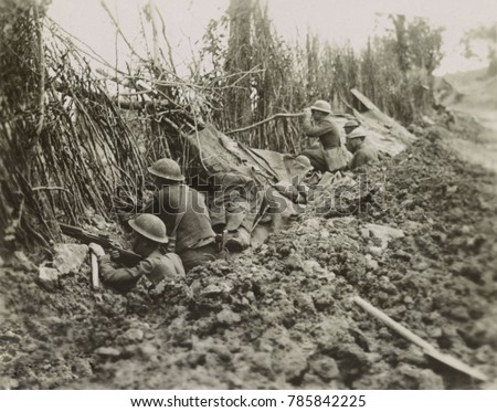 American soldiers in front line trench during the Meuse-Argonne Offensive, France, World War1. They are about 1200 yards from the German line on Oct. 3, 1918 as they occupy a camouflaged trench abando