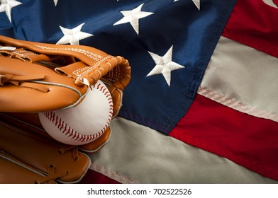 American sports and college athletics concept with the USA flag in the background and macro on a vintage baseball glove holding a ball with copy space