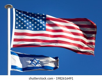American stars and stripes above the flag of Israel. Representing United States of America protection of Israel in the Israeli–Palestinian conflict.