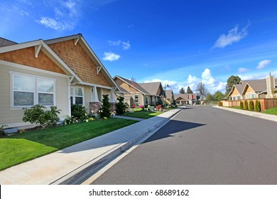 American street of new development with rambler homes.