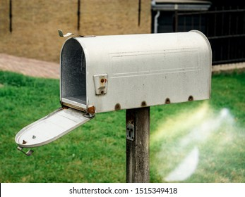 American style open mailbox in front of the house with no letters or newspapers parcels inside