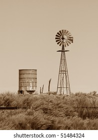 American Style Water Pumping Windmill and Water Tower in sepia