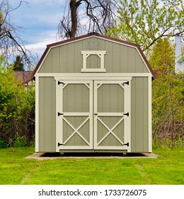 American style wooded shed. A shed is typically a simple, single-story roofed structure in a back garden or on an allotment that is used for storage, hobbies, or as a workshop. Exterior view