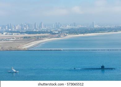 American submarine leaving naval base in San Diego harbor, California