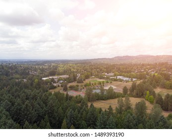 american suburbs and mountains with forests at sunset. View from above