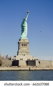American symbol - Statue of Liberty. It's a colossal neoclassical sculpture on Liberty Island in New York Harbor in New York City, in the United States.