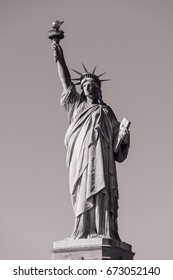 American symbol - Statue of Liberty. It's a colossal neoclassical sculpture on Liberty Island in New York Harbor in New York City, in the United States. (Black and White)