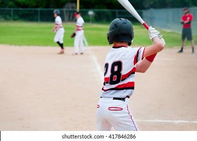 American teenage baseball player batting with copy-space.