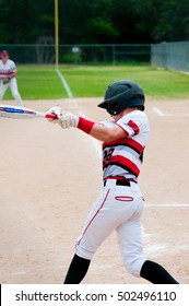 American teenage baseball player with big swing.