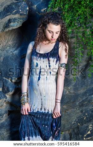 72d9f2c8bcd American Teenager Girl wearing patterned long dress, chunky chain bracelet,  arm cuff bracelet,