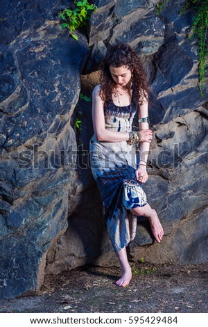 d5a6f091f43 American teenager girl wearing patterned long dress, chunky chain bracelet,  arm cuff bracelet,