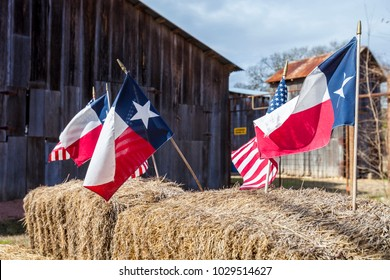 The American and Texas flags arranged on straw bales, rustic independence day decoration