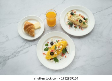 American and Thai breakfast set on the marble background