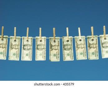 american twenty dollar bills hung on a clothesline.