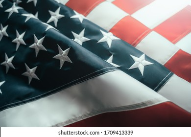 American or USA Flag in sunlight, close up.