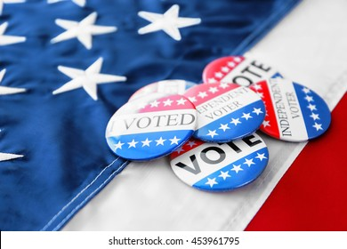 American vote badges on national flag background