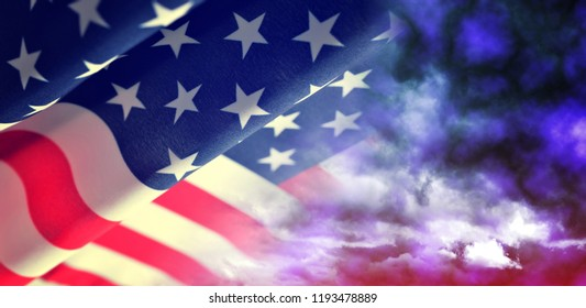 American waving flag with stormy sky.