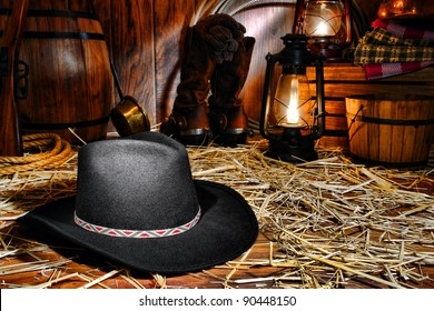 American West rodeo cowboy traditional black felt hat on straw covered wood  floor in vintage ranch 00c77152b62d