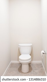 American White Toilet with Tan Tiled Floor