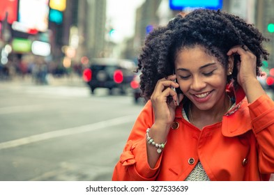 american woman making a phone call in Time Square, New york. urban lifestyle concept