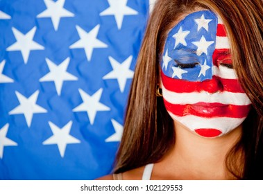 American woman with the USA flag painted on her face ���� isolated