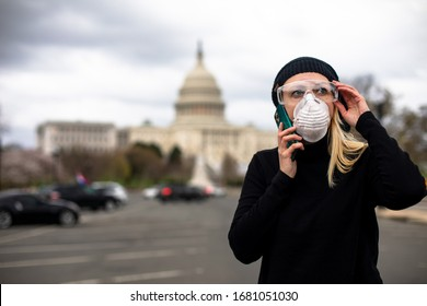 An American woman wears a mask and goggles at the U.S. Capitol building in Washington, D.C. to protect herself from the COVID-19 coronavirus.