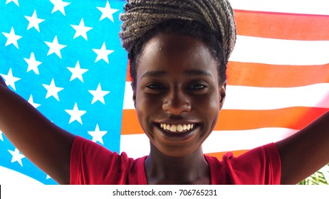 American Young Black Woman Celebrating with USA Flag