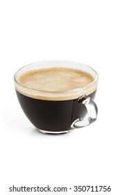 Americano black coffee with natural foam in a transparent glass cup on a white background isolated
