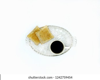 Americano Black Coffee in the black and white cup with black cat cartoon on white background with Toasts for easy breakfast on the glass plate in the white background.