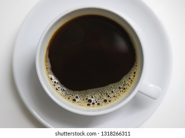 americano bubble on top, A cup of coffee Americano with l perfect ittle bubble close-up in a white cup of coffee