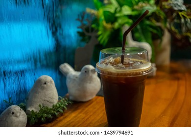 Americano Coffee On the table Background rain