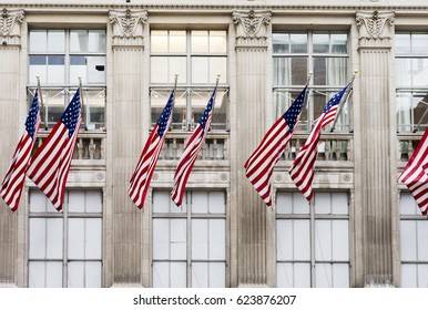 Americans flags in the windows of public state historical building.