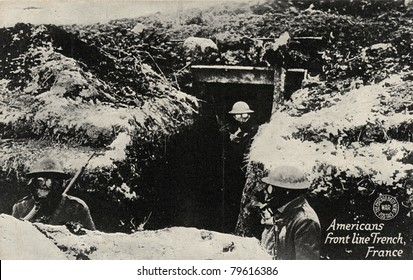Americans Front Line Trench - Early 1900's WWI postcard depicting Americans in a front line trench in France with gas masks on.