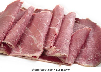 American-style corned beef closeup, with the slices folded back