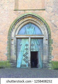 """Amersfoort. February-13-2018. Entrance to the Church Tower """"Lange Jan"""" from the 15th century is 98.33 meters high in the city of Amersfoort. The Netherlands"""